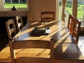 The Dairymaid's dining table in the sitting room